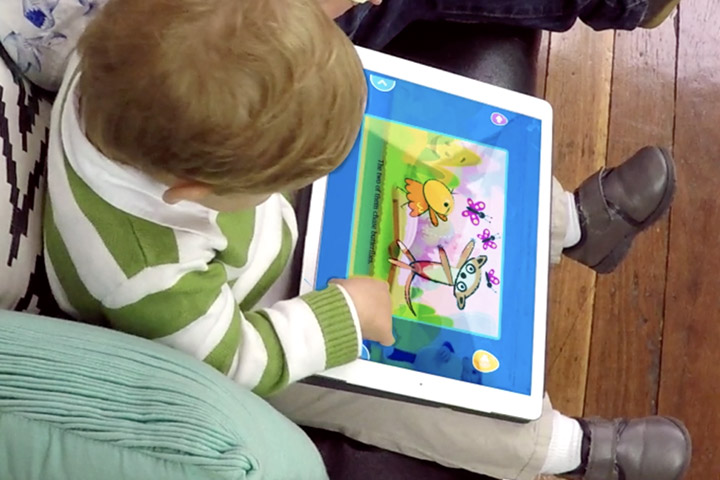 Toddler playing a ABC Reading Eggs Junior activity on a tablet
